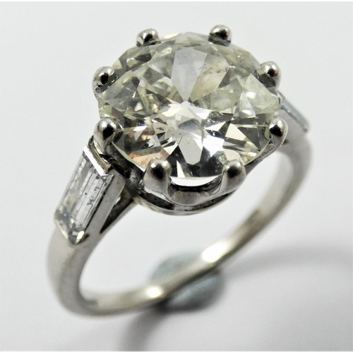 107 - An Art Deco French platinum single stone diamond ring, claw set with an old brilliant cut stone, cal...