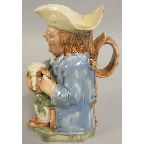 348 - An 18th century Ralph Wood pearlware Toby Jug, with foaming mug, decorated with a blue coat and gree...