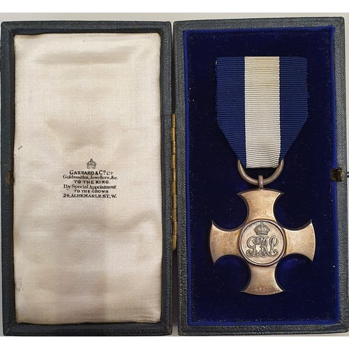 1000 - A George V silver Distinguished Service Cross to Gnr George Gates R.N., cased, together with a quant...
