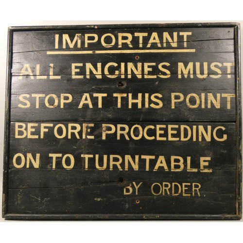 310 - A black and cream painted wooden sign relating to locomotives entering a turntable, 66 x 80 cm.