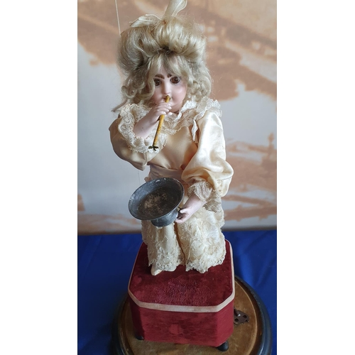 371 - A French lady blowing bubbles automaton with a closed mouth Jumeau head, with brown glass eyes, pier...