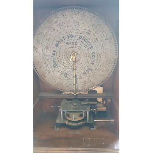408 - A large Polyphon music penny operated automaton, Model 104, c.1880, with 9 records, the two-part cas...