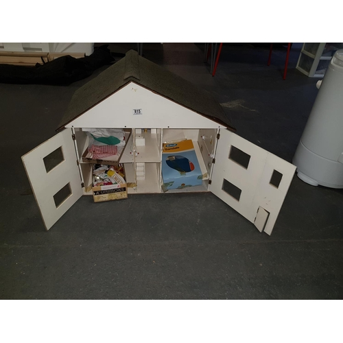 815 - Wooden dolls house and dolls furniture...