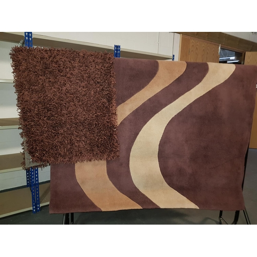 840 - Two rugs...