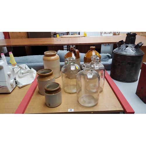 29 - Glass demi johns, earthenware pots etc....