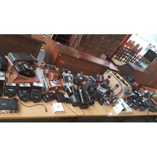 57 - Large collection of cameras, lenses, flash equipment etc including early Kodak, Silette- L vintage c...