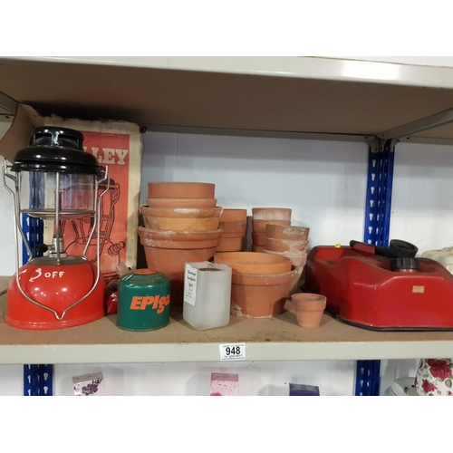 948 - Metal petrol can, tilley stormlight and clay pots...