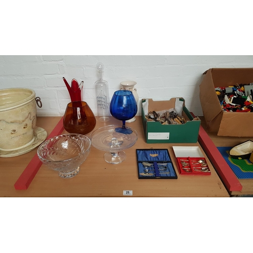 26 - Large glass ship in bottle, vases and tazza and a quantity of loose cutlery and sets...