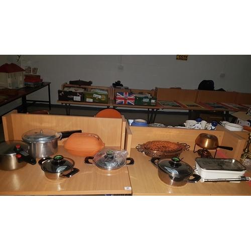 21 - Quantity of saucepans, copper fondue set etc including AMC pans...