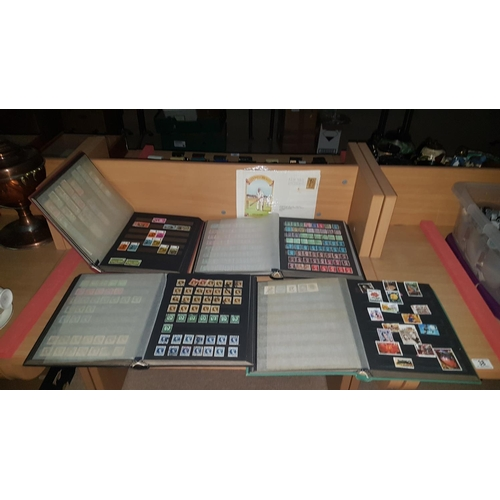 38 - Four stamp albums  - mainly British...