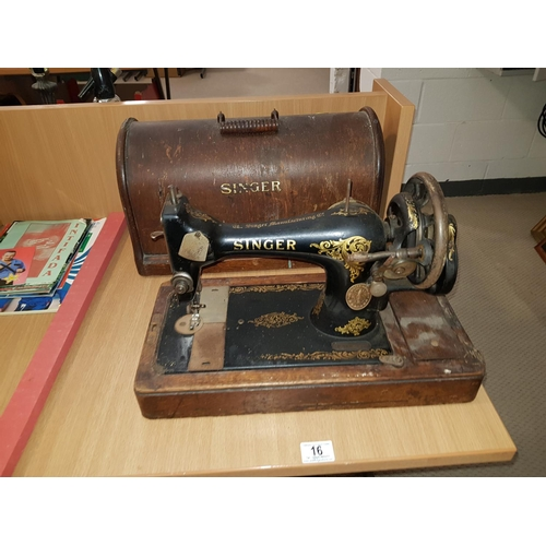 16 - A Singer sewing machine...