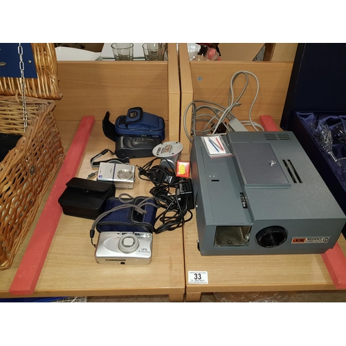 33 - Gnome Regent turbo auto slide projector and quantity of cameras...