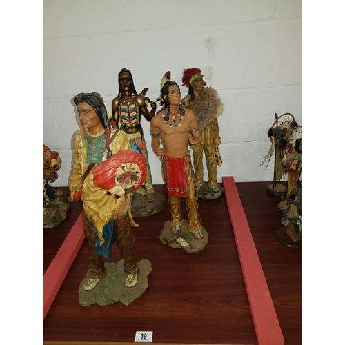 39 - Four large American Indian statues...