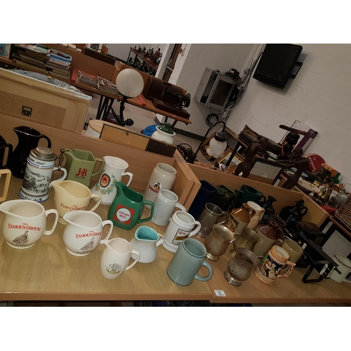 5 - Quantity of breweriana including jugs, steins and pump...