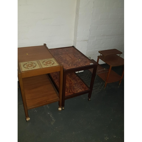 515 - Two tile topped tea trolleys, magazine holder and small telephone table...