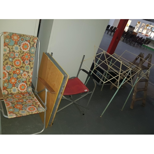 539 - Quantity of fold up chairs, fold up table, wooden ladders...