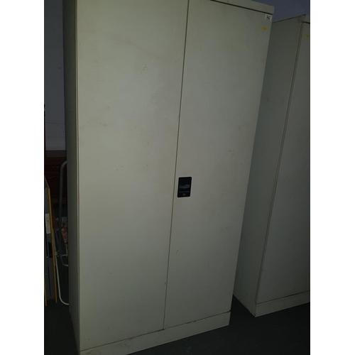 542 - Tall metal cupboard...