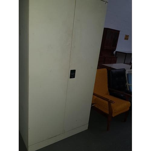 543 - Tall metal cupboard...