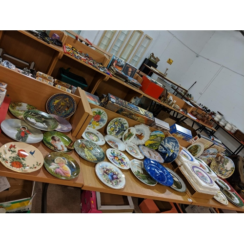 31 - Large quantity of decorative and collectors plates including Royal Worcester, Royal Doulton and Coal...