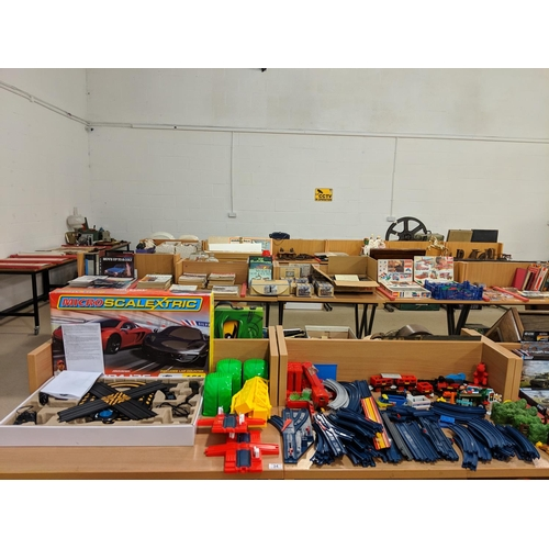 34 - Boxed Micro Scalextric and a quantity of Tomy trains/ carriages and track...