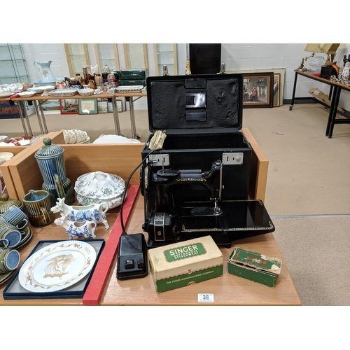 38 - Boxed Singer sewing machine 222K with accessories...