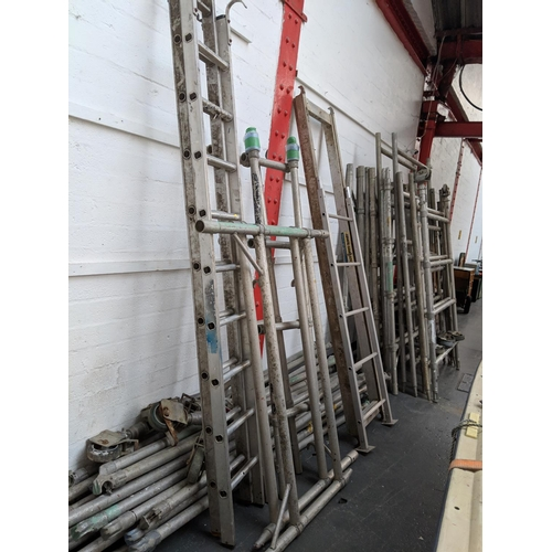 502 - A large aluminium scaffold tower with bracing,wheels etc....