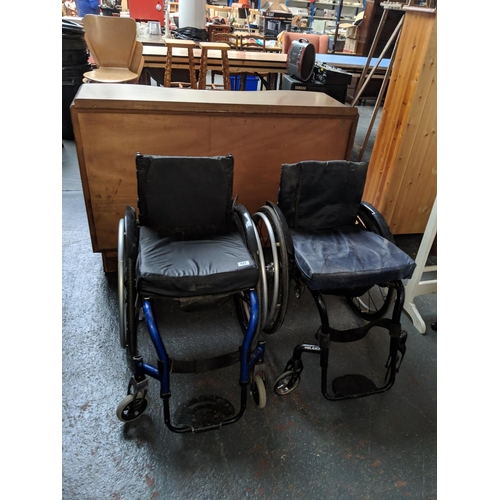 527 - Two lightweight sporting wheelchairs...