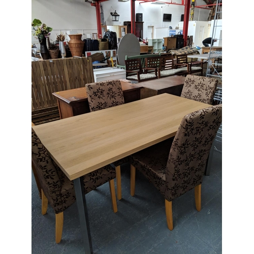 538 - Beech effect dining table and four chairs...