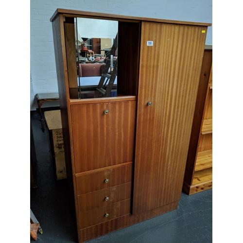 559 - A Compactum wardrobe...