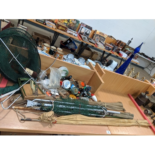 21 - A collection of vintage fishing items- reels, rods, nets etc....