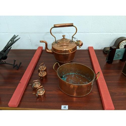 48 - A large copper kettle, smaller kettles etc....
