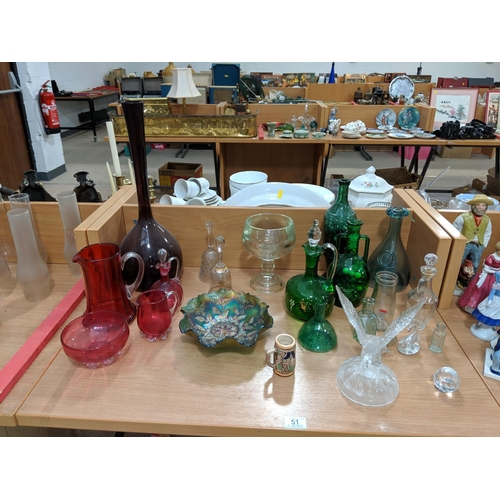 51 - A selection of glass bottles, vases and jugs...