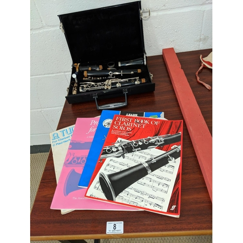 8 - Boxed Vito Resotone clarinet with tuition books...