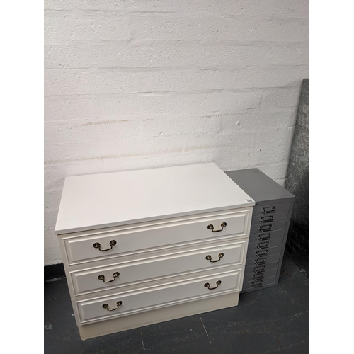760 - A three drawer white chest of drawers and a ten drawer Bisley metal set of drawers...