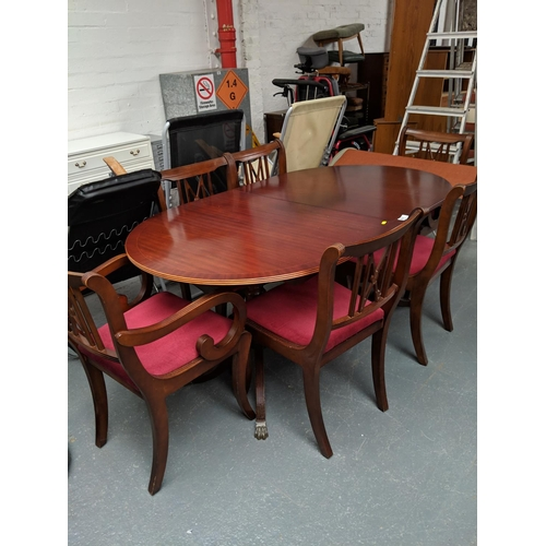 801 - A regency style dining table and six chairs...