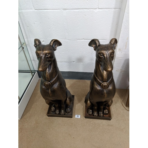 54 - A pair of cast iron large dog figures...