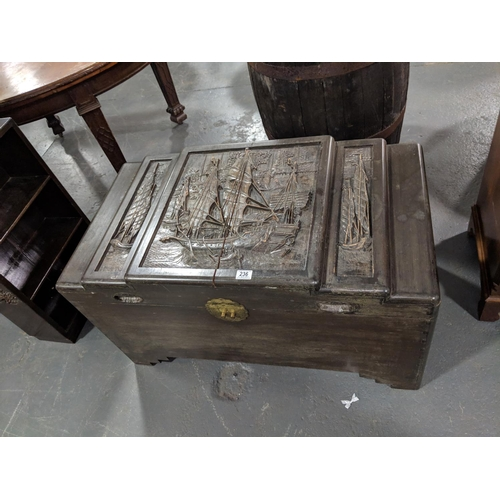 236 - An oriental, carved,camphor chest...