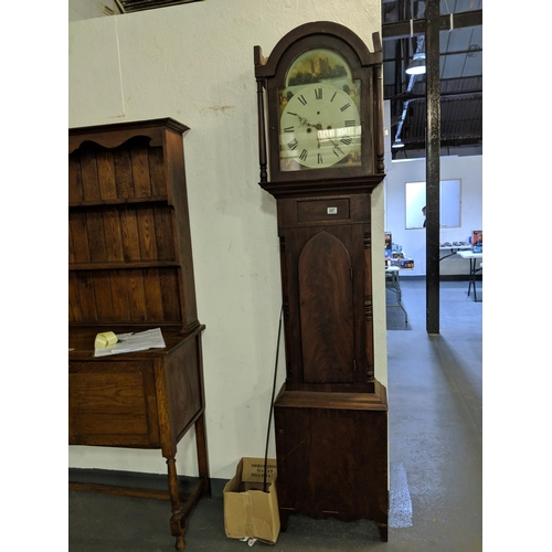 247 - A grandfather clock- 8 day - in mahogany case...