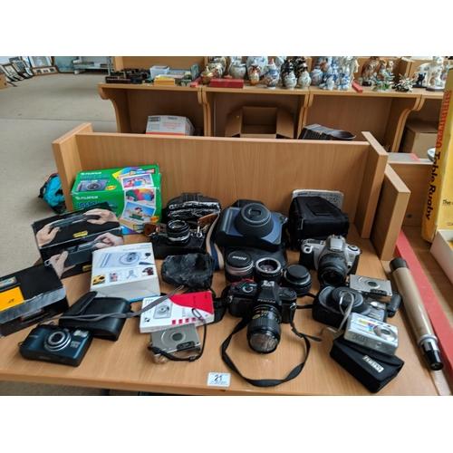 21 - Cameras, lenses including Canon, Fujifilm etc....
