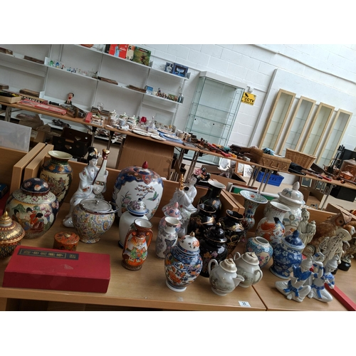 30 - A collection of oriental style china and figurines etc...