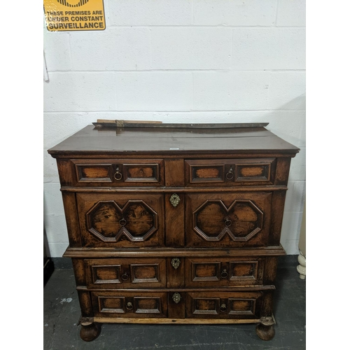 205 - An 18th century oak five drawer chest on chest/ attic chest...