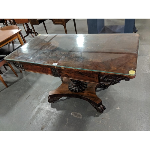 222 - A Rosewood veneered William IV library table...