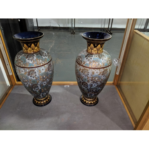 470 - A pair of Doulton Lambeth vases, 18 inches in height marked' OP' which is the impressed mark of arti...