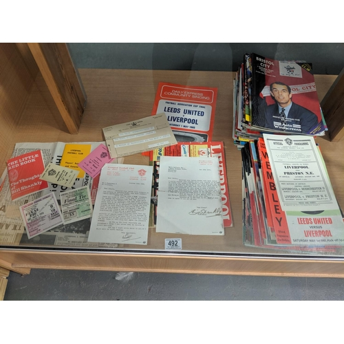 492 - A quantity of football programmes including Cup Final programmes 1960s-1990s plus newspapers, match ...