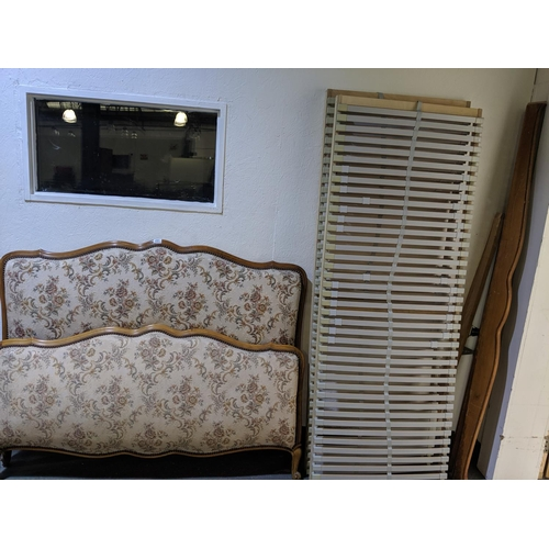 251 - A French, upholstered double bed frame...