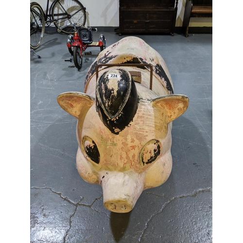 234 - A large fairground ride- pig...