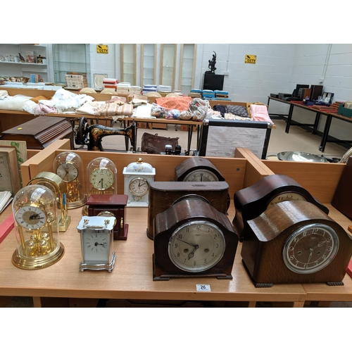 26 - A collection of wooden mantle clocks including Smiths, anniversary clocks etc....