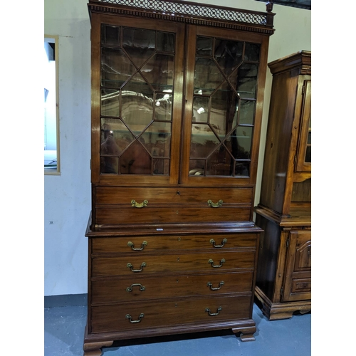 230 - A Georgian , mahogany secretaire bookcase...
