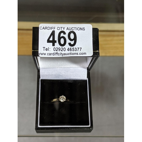 469 - An 18k gold engagement ring with single diamond...