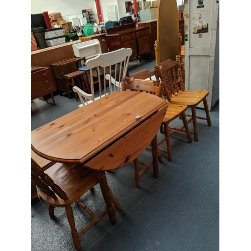 536 - A pine table and four chairs...